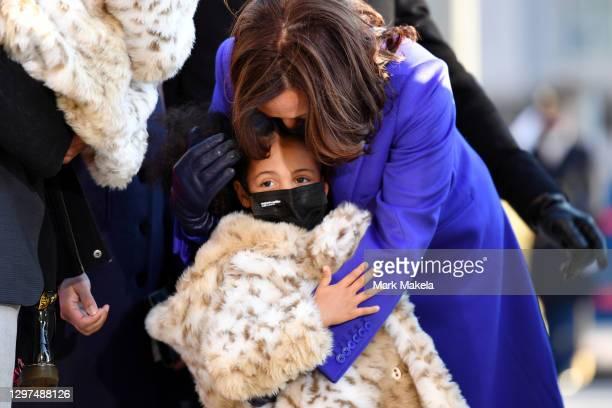 Vice President Kamala Harris walks the abbreviated parade route with her great niece Amara after U.S. President Joe Biden's inauguration on January...