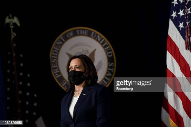 Vice President Kamala Harris wears a protective mask before speaking during an event on the implementation of the American Rescue Plan's investment...