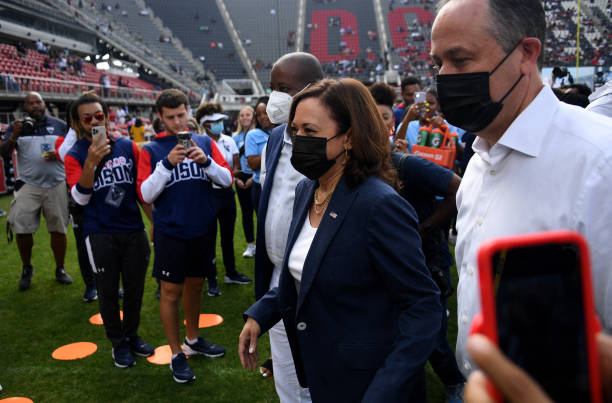 Vice President Kamala Harris, with Howard University President Wayne A. I. Frederick and Second Gentleman Doug Emhoff , leaves the field after...