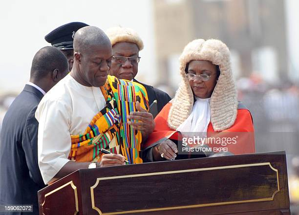 Vice President Kwesi AmissahArthur signs documents after swearing an oath at Independence Square Accra on January 7 2013 Mahama has been swornin into...
