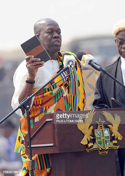 Vice President Kwesi AmissahArthur takes oath holding the Bible at Independence Square Accra on January 7 2013 Mahama has been swornin into office...