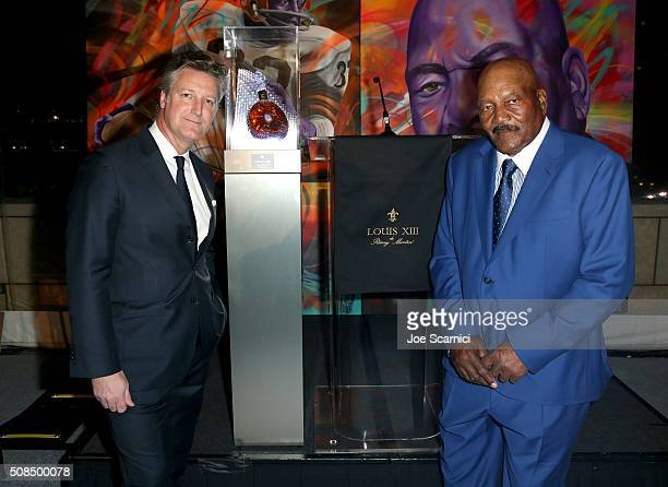 Vice President Louis XIII Americas Yves De Launay and former Cleveland Browns running back and NFL Hall of Famer Jim Brown attends Haute Living And...