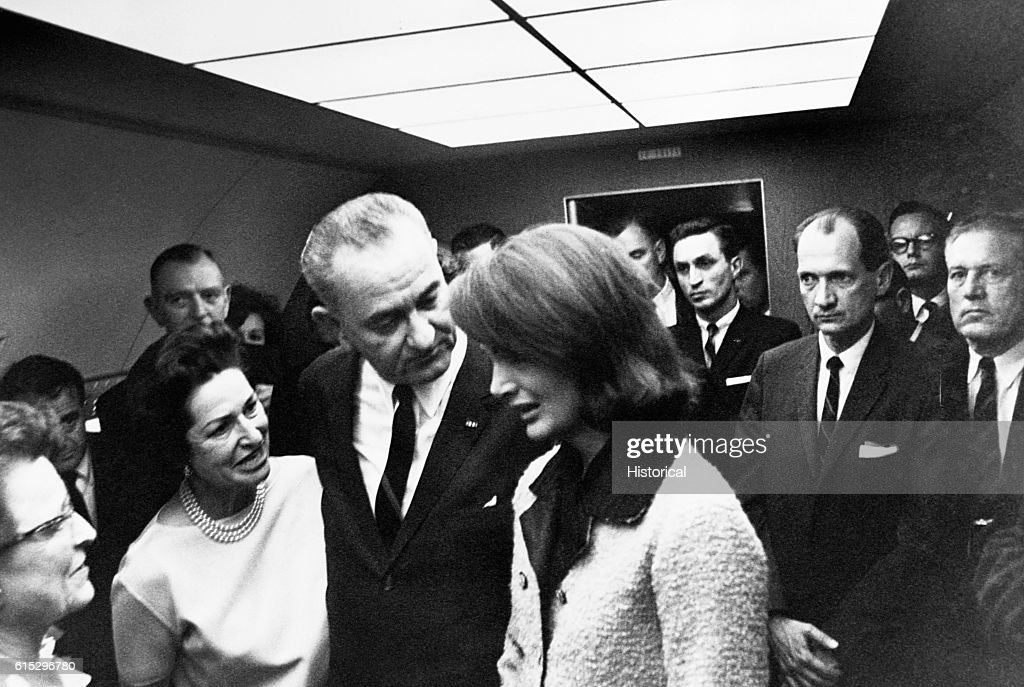 Vice President Lyndon B. Johnson and wife Lady Bird comfort Jacqueline Kennedy aboard Air Force One after the assassination of President Kennedy.