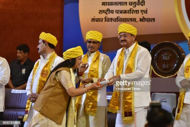 Vice President M Venkaiah Naidu presents degrees during the 3rd convocation ceremony of Makhanlal Chaturvedi National University of Journalism and...