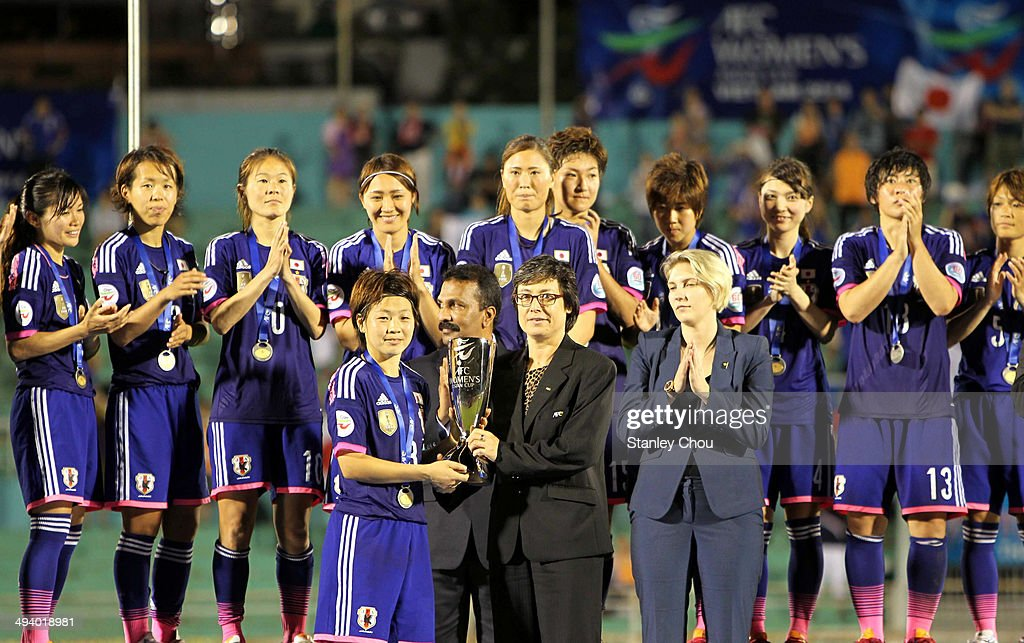 Vice President Maya Dodd presents the Asian Cup Trophy to Aya Miyama of Japan after they defeated Australia 1-0 during the AFC Women's Asian Cup Final match between Japan and Australia at Thong Nhat Stadium on May 25, 2014 in Ho Chi Minh City, Vietnam.