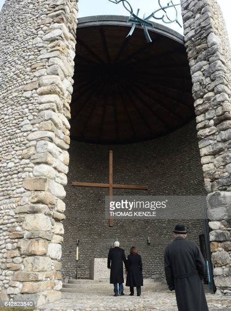US Vice President Michael Richard Pence and his wife Karen Pence stand inside the Catholic Mortal Agony Of Christ Chapel at the Dachau Concentration...