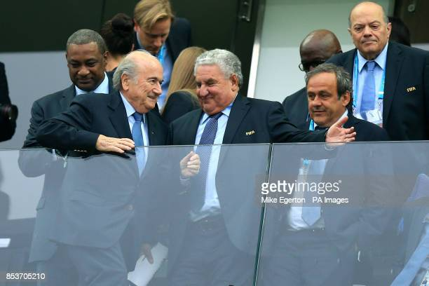 Vice president Michel Platini of FIFA and president Sepp Blatter of FIFA with FIFA vicepresident Jeffrey Webb in the stands