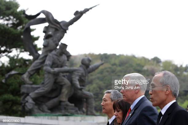 Vice President Mike and his wife Karen Pence pay a silent tribute at Seoul National Cemetery on April 16, 2017 in Seoul, South Korea. During the...