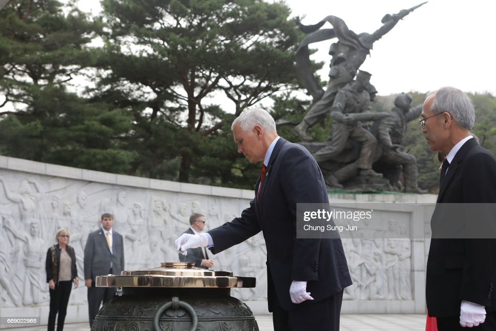 U.S. Vice President Mike burns incense at Seoul National Cemetery on April 16, 2017 in Seoul, South Korea. During the three day visit to South Korea, Vice President Pence will spend Easter Sunday with the U.S. and S. Korean troops and their families. He will also meet with Korea's acting president Hwang Kyo-ahn, the national assembly speaker Chung Sye-kyun and local business leaders.