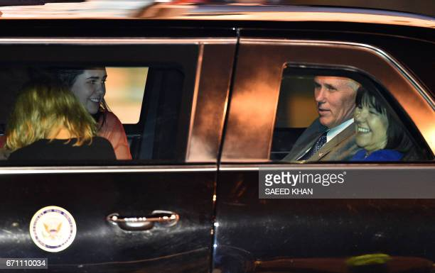 US Vice President Mike Pence 2nd R his wife Karen and their two daughters Audrey and Charlotte leave the airport following their arrival in Sydney on...