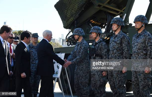 US Vice President Mike Pence accompanied by Japan's Defence Minister Itsunori Onodera meets with members of the Japan SelfDefence Force as he...