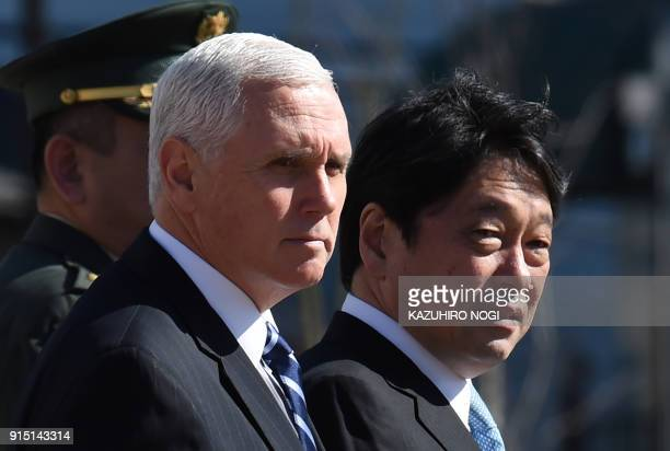 US Vice President Mike Pence accompanied by Japan's Defence Minister Itsunori Onodera arrives to inspect a PAC3 surfacetoair missile system during a...