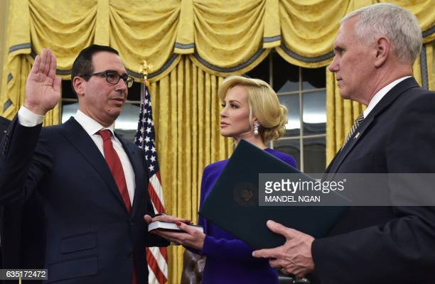 Vice President Mike Pence administers the oath of office to Treasury Secretary Steven Mnuchin watched by Mnuchin's fiancee Louise Linton in the Oval...