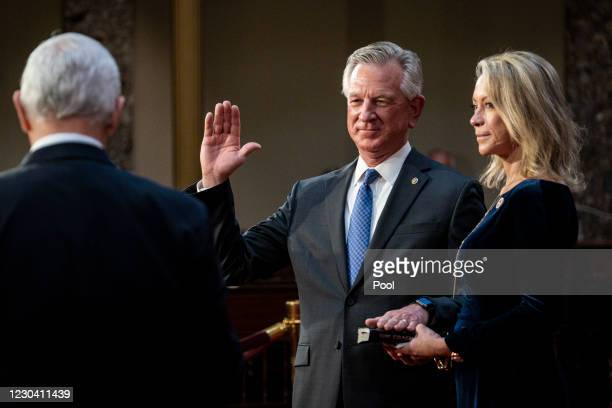 Vice President Mike Pence administers the Senate oath of office to Tommy Tuberville as his wife, Suzanne, holds the bible during a mock swearing-in...