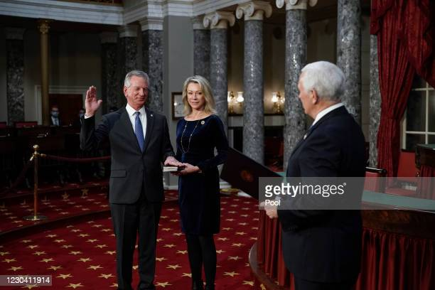 Vice President Mike Pence administers the Senate oath of office to Sen. Tommy Tuberville , the former Auburn University football coach, as his wife,...