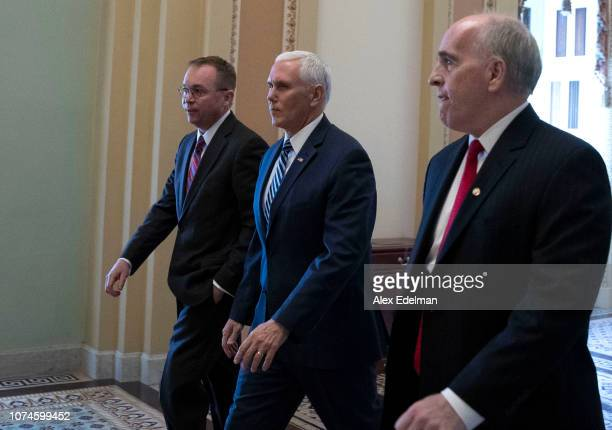 Vice President Mike Pence and acting White House Chief of Staff Mick Mulvaney depart the US Capitol on December 22 2018 in Washington DC Pence and...