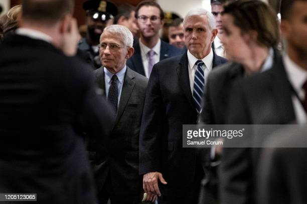Vice President Mike Pence and Anthony Fauci Director of the National Institute of Allergy and Infectious Diseases walk to where Congressional...