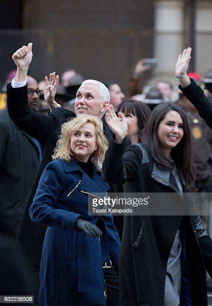 Vice President Mike Pence and daughters Charlotte Pence and Audrey Pence walk in the Inaugural Parade on January 20 2017 in Washington DC Donald J...