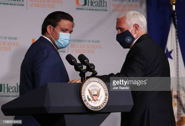 Vice President Mike Pence and Florida Gov Ron DeSantis leave after participating in a press conference at the the University of Miami Miller School...
