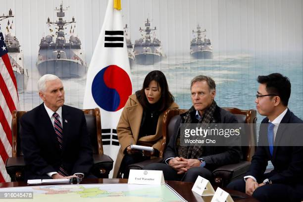 S Vice President Mike Pence and Fred Warmbier the father of Otto warmbier who was imprisoned in North Korea for 17 months listen traslation of Ji...