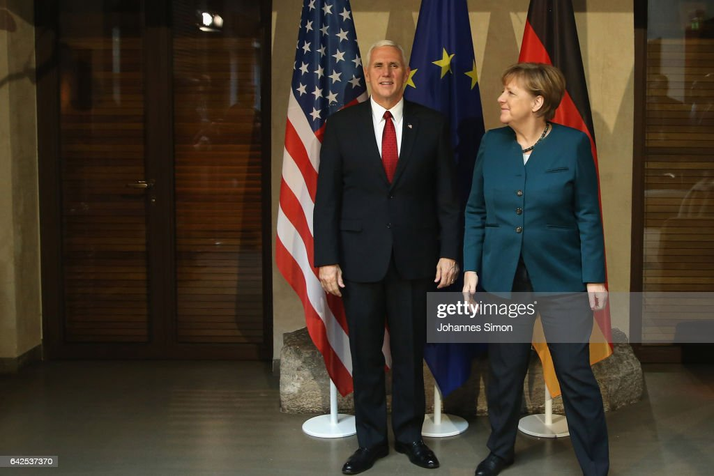 U.S. Vice President Mike Pence (L) and German chancellor Angela Merkel pose at the 2017 Munich Security Conference on February 18, 2017 in Munich, Germany. The 2017 Munich Security Conference, which brings together leading government figures from across the globe to discuss issues of common security concern, is taking place in the wake of the ascendence of Donald Trump to the U.S. presidency and the appointment of a new U.S. government cabinet. Trump has repeatedly called for a more isolationist United States, which has caused alarm among many world leaders concerned about the U.S.'s continued commitment to matters of global security.