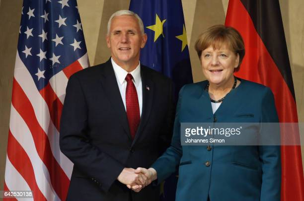 S Vice President Mike Pence and German chancellor Angela Merkel shake hands at the 2017 Munich Security Conference on February 18 2017 in Munich...
