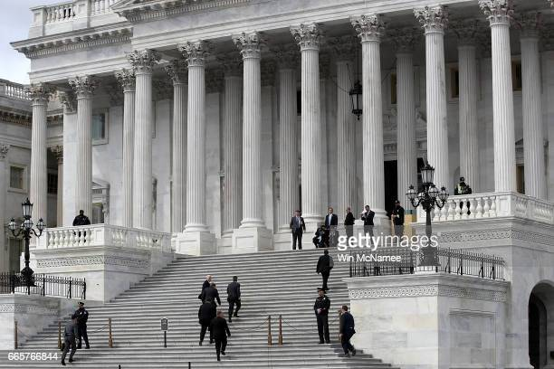 S Vice President Mike Pence and his entourage arrive on the steps of the US Senate to preside over the confirmation vote for US Supreme Court nominee...