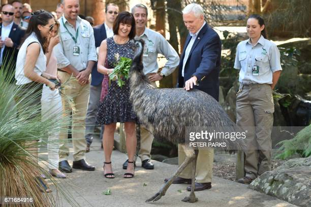 US Vice President Mike Pence and his wife Karen and daughters Audrey and Charlotte look at an emu during a visit to Taronga Park Zoo in Sydney on...
