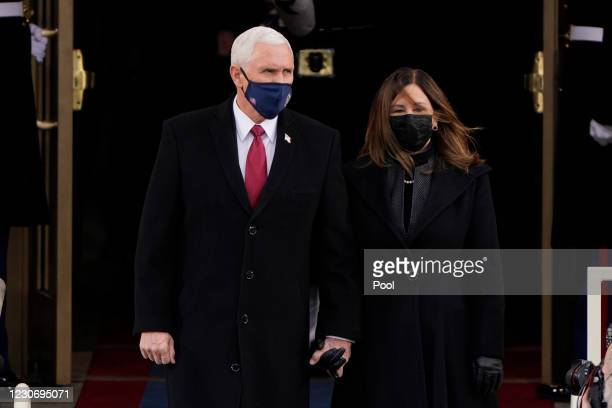 Vice President Mike Pence and his wife Karen, arrive for the 59th inaugural ceremony on the West Front of the U.S. Capitol on January 20, 2021 in...