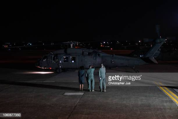 S Vice President Mike Pence and his wife Karen Pence are transported in a Black Hawk helicopter after arriving at Yokota Air Base on November 13 2018...