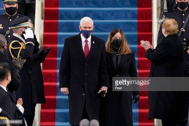Vice President Mike Pence and his wife Karen Pence attend the 59th inaugural ceremony on the West Front of the U.S. Capitol on January 20, 2021 in...