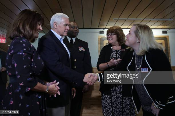 S Vice President Mike Pence and his wife Karen Pence greet facility staff at the USO Warrior and Family Center November 22 2017 in Bethesda Maryland...