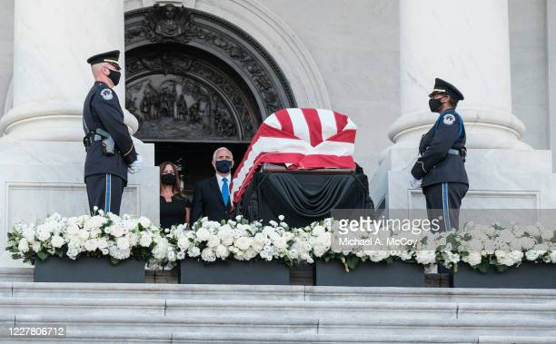 S Vice President Mike Pence and his wife Karen Pence pay their respects to Rep John Lewis as his flagdraped casket is displayed at the top of the US...