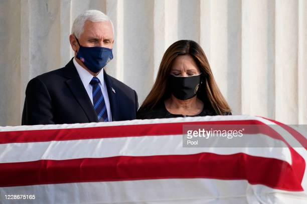 Vice President Mike Pence and his wife Karen Pence pay their respects at the casket bearing the remains of Justice Ruth Bader Ginsburg at the steps...