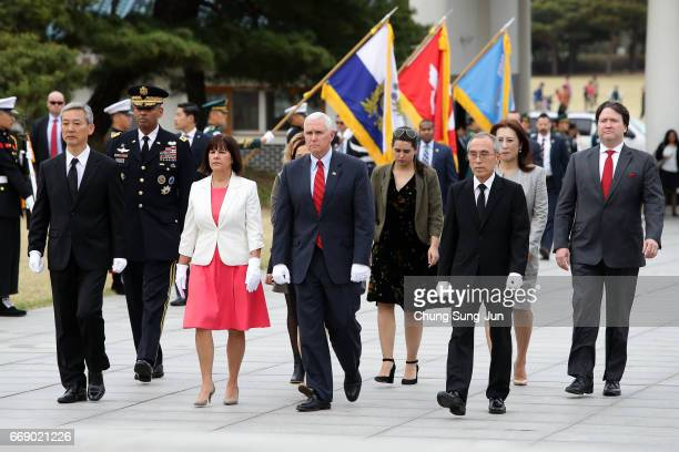 Vice President Mike Pence and his wife Karen Pence visit at Seoul National Cemetery on April 16, 2017 in Seoul, South Korea. During the three day...