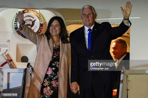 S Vice President Mike Pence and his wife Karen Pence wave as they exit Air Force Two upon their arrival at Yokota Air Base on November 13 2018 in...