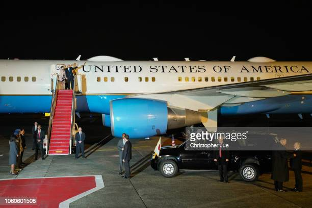S Vice President Mike Pence and his wife Karen Pence wave as they prepare to exit Air Force Two upon their arrival at Yokota Air Base on November 13...