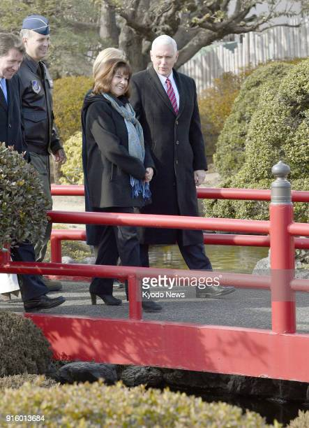 US Vice President Mike Pence and his wife Karen stroll around a Japanese garden in the US military's Yokota Air Base in a Tokyo suburb on Feb 8 2018...