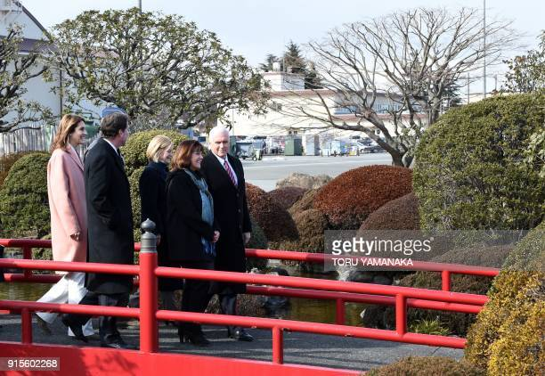 US Vice President Mike Pence and his wife Karen walk through a Japanese garden during a visit to Yokota Air Base at Fussa near Tokyo before their...