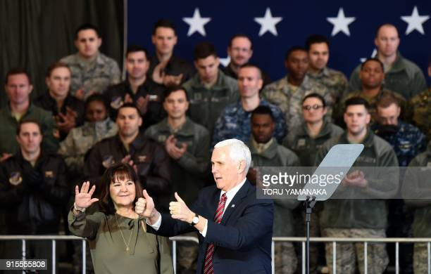 US Vice President Mike Pence and his wife Karen wave as he arrives to address US soldiers at Yokota Air Base at Fussa near Tokyo on February 8 2018...