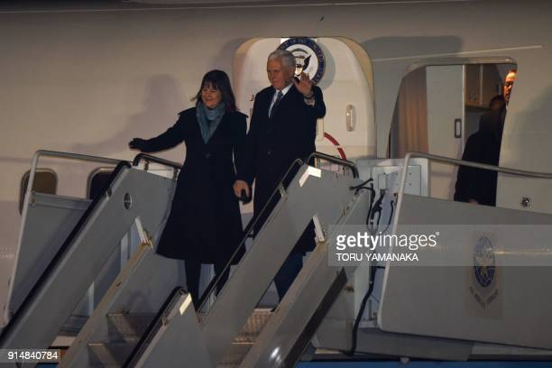US Vice President Mike Pence and his wife Karen wave as they arrive at Yokota Air Base at Fussa in Tokyo on February 6 2018 / AFP PHOTO / Toru...