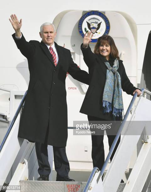 US Vice President Mike Pence and his wife Karen wave at the US Yokota Air Base in a Tokyo suburb on Feb 8 as they leave for South Korea ==Kyodo