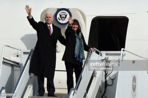 US Vice President Mike Pence and his wife Karen wave upon their departure at Yokota Air Base at Fussa near Tokyo on February 8 2018 Pence is on the...