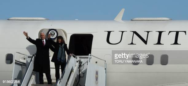 US Vice President Mike Pence and his wife Karen wave upon their departure to South Korea at Yokota Air Base at Fussa near Tokyo on February 8 2018...