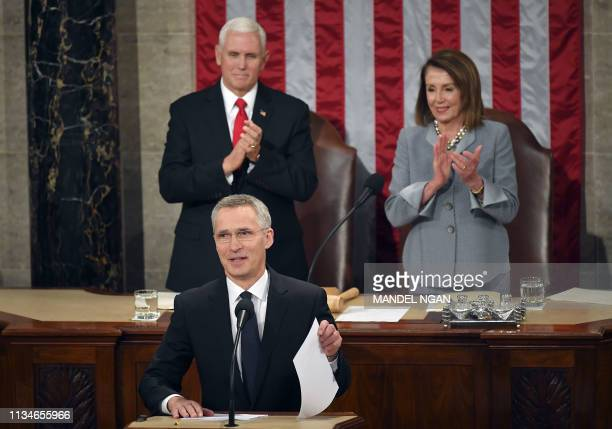 US Vice President Mike Pence and House Speaker Nancy Pelosi applaud before NATO Secretary General Jens Stoltenberg addresses a joint meeting of...