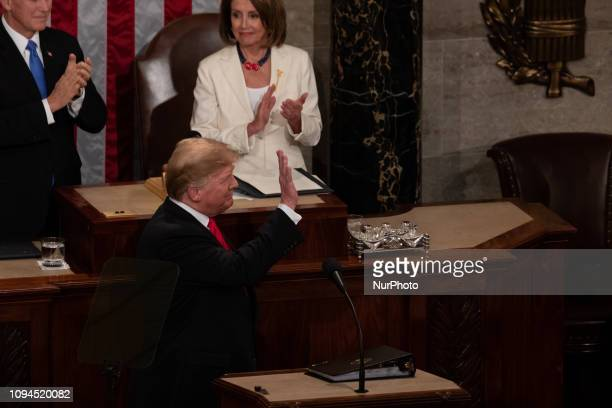 Vice President Mike Pence and House Speaker Nancy Pelosi applaud US President Donald Trump as he arrives to deliver his second State of the Union...