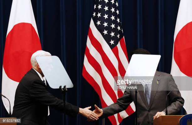 US Vice President Mike Pence and Japan's Prime Minister Shinzo Abe shake hands during their joint announcement after their meeting at Abe's official...