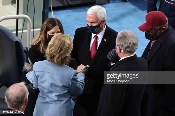 Vice President Mike Pence and Karen Pence greet former President George W. Bush and Laura Bush at the inauguration of U.S. President-elect Joe Biden...