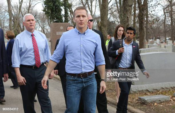 Vice President Mike Pence and Missouri Gov. Eric Greitens walk through the Chesed Shel Emeth Cemetery in University City, Mo., on Wednesday, Feb. 22,...