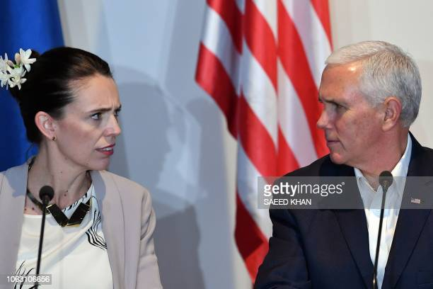 US Vice President Mike Pence and New Zealand's Prime Minister Jacinda Ardern speak at an electricity projects signing ceremony during the AsiaPacific...